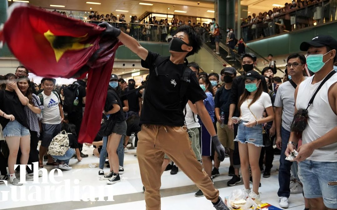 Hong Kong protesters trample Chinese flag as protests continue