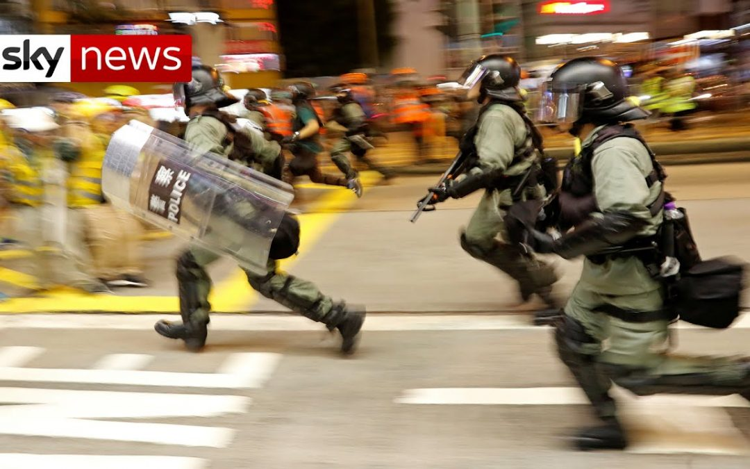 Police fire tear gas at protesters in Hong Kong